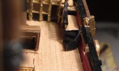 Close up the deck, showing staircase, companionway and bulkhead.