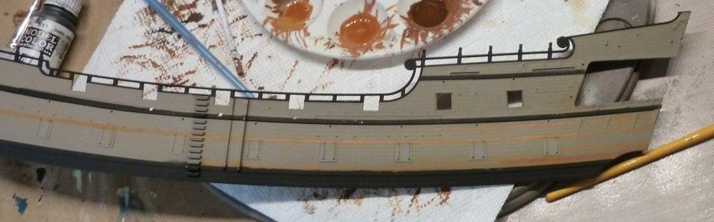 primed hull painting  first planks.jpg