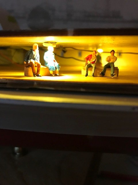 four people in illumination on saloon deck.jpg