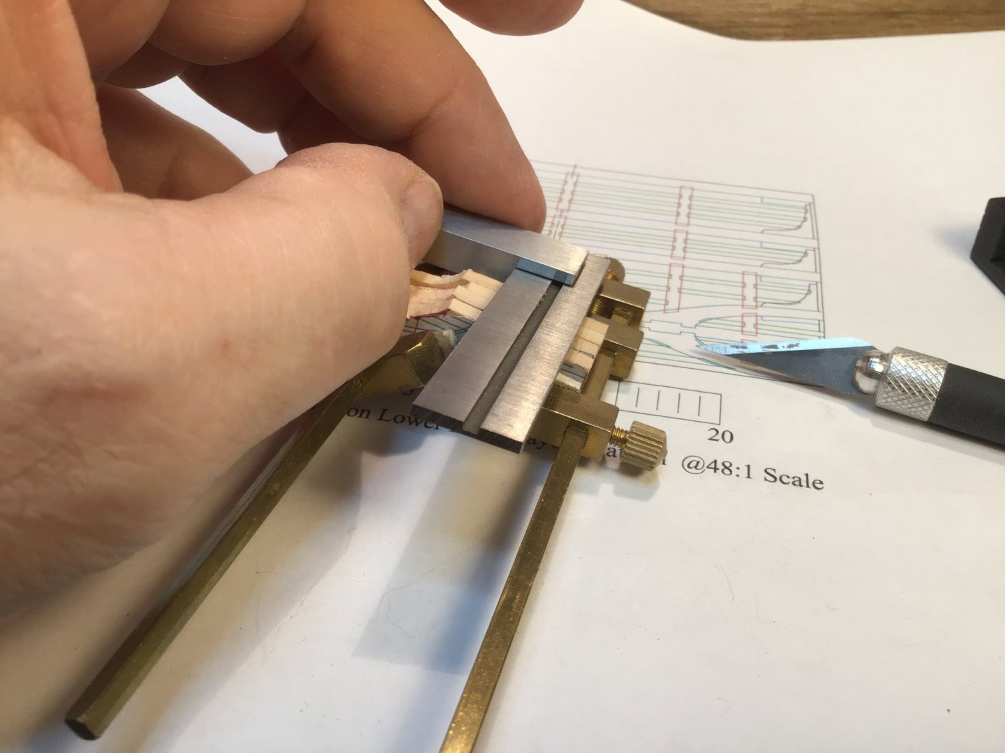 Using a square and knife to mark the notches.