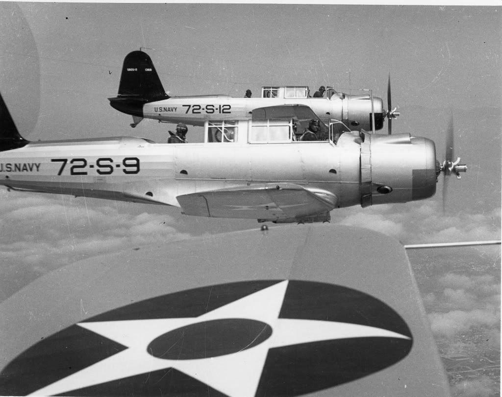 SB2U-2swithScoutingSquadronSeventy-TwoVS-72picturedinflight-1.jpg.e3dc5e49de513b73ad2f6859ee6de656.jpg
