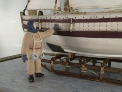 Original figure of Shackleton standing on the ice next to the James Caird